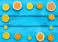 Colorful citrus fruits on the rustic blue background Stock Photography