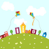 Colorful City. An illustration of a city with colorful kites, buildings on a green landscape, during summer. Also in vector format Royalty Free Stock Image