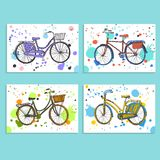 Colorful city bicycles set. Set of four stylish hand drawn city bike on white background with colorful spots Royalty Free Stock Photos
