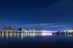 Colorful City Lights Reflected on Water Royalty Free Stock Images