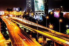 Colorful of city modern buildings night and road light abstract. Background, decorated with de-focus bokeh lights cities offices of reflecting building in Stock Image