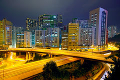 Colorful city night with buildings and bridge Royalty Free Stock Photo