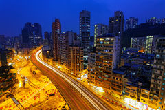 Colorful city night with lights of cars motion blurred in hong k Stock Images
