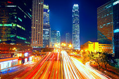 Colorful city night with lights of cars motion blurred in hong k Stock Photography