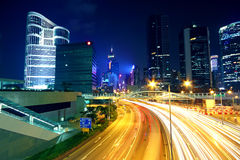 Colorful city night with lights of cars motion blurred in hong k Royalty Free Stock Image