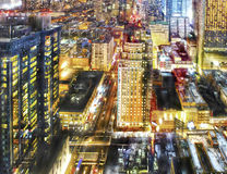 Colorful city nightlife. Aerial view of a colorful city nightlife and illuminated buildings of Manhattan, New York Royalty Free Stock Photos