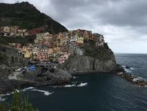 Colorful city on a rock. Exotic architecture Manarola on a rock. A view of the harbor. Italy royalty free stock image