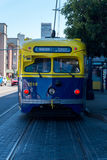San Francisco muni railroad streetcar painted in yellow and blue colors Stock Images