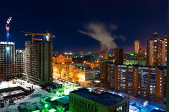 Colorful cityscape and building construction in Yekaterinburg city at night. Colorful view of building construction in Yekaterinburg city at night snow winter royalty free stock photo