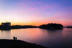Colorful cityscape of Khmelnytskyi city at night, after sunset, along the river Southern Bug, Ukraine Stock Photos