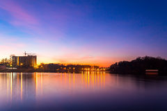 Colorful cityscape of Khmelnytskyi city at night, after sunset, along the river Southern Bug, Ukraine Stock Photo