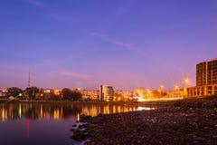 Colorful cityscape of Khmelnytskyi city at night, after sunset, along the river Southern Bug, Ukraine Stock Image
