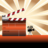 Colorful clapboard. Abstract colorful illustration with colored clapboard and small movie camera shape Stock Photos