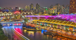 Colorful Clarke Quay Singapore Night Scene. Clarke Quay is the most vibrant and colorful place on the Singapore River, architecture here is mix of restored old Stock Photo