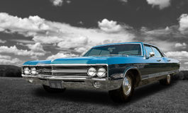 Colorful classic old car - on black and white background Stock Photography