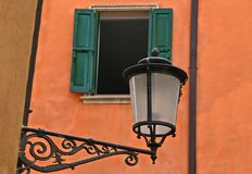 Colorful classic venetian windows and orange old building facade in beautiful town Padua, Italy. Colorful classic venetian windows and orange old building facade stock image