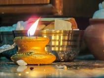 Colorful clay diya lamps lit during Diwali celebration. Stock Photos
