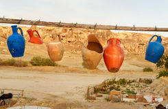 Colorful clay jugs hanging on line in Goreme. Cappadocia. Turkey royalty free stock photography