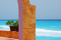 Colorful clay pots. With blue caribbean ocean Stock Images