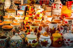 Colorful clay pots. On a beautiful display in a sellers shop Stock Photos