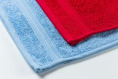Colorful clean cotton towels isolated on white Royalty Free Stock Images