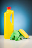 Colorful cleaning  equipment and blue background Royalty Free Stock Photos