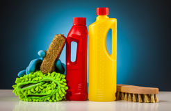 Colorful cleaning equipment and blue background Stock Images
