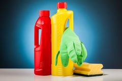 Colorful cleaning mop equipment and blue background Royalty Free Stock Photo