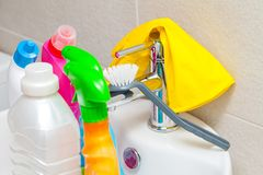 Colorful cleaning products in the bathroom stock image