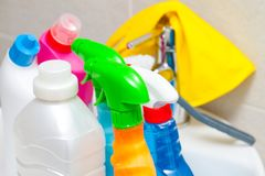 Colorful cleaning products in the bathroom royalty free stock photography