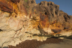 Colorful cliffs on the beach Stock Photo