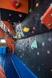 Colorful climbing modern gym Stock Photography