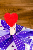 Colorful clip and gift box Stock Photography