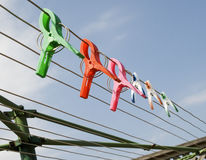 Colorful clips on the clothesline Royalty Free Stock Image