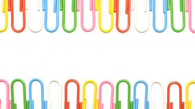 Colorful clips isolated. Colorful clips set in rows for wallpaper Royalty Free Stock Images