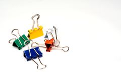 Colorful Clips in Pile. Colorful paper clips dumped in a pile Stock Photo