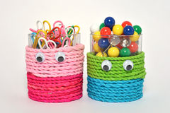 Colorful clips and pins in cutie cup isolated. A colorful clips and pins in a decorated cups isolated Stock Image