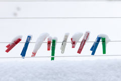 Colorful Clips Washing Laundry Covered Snow Strip Rope Outdoor. Winter. Stock Photography