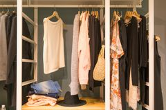 Colorful clorhes on racks in a fashion boutique.  Royalty Free Stock Photos