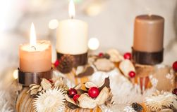 Closeup of Advent wreath with two burning candle and Christmas lights in background. Colorful closeup of Advent wreath with two burning candle and white royalty free stock photography
