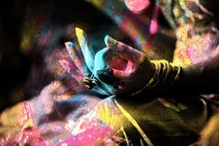 Colorful closeup of woman hand in mudra gesture practice yoga outdoor double exposure royalty free stock photography