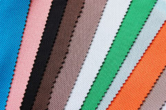 Colorful cloth. A pile of colorful cloth for clothes making stock photo