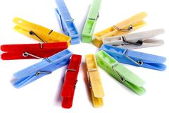 Colorful cloth pegs. Close up view of some colorful cloth pegs isolated on a white background royalty free stock image
