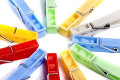 Colorful cloth pegs. Close up view of some colorful cloth pegs isolated on a white background royalty free stock photography