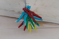 Colorful cloth pegs. Clothpegs on a clothline in different colors Stock Photography