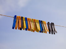 Colorful clothepins on the line Royalty Free Stock Photos