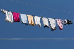 Colorful clothes on blue sky Stock Photography