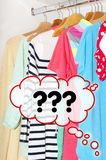 Colorful clothes for choice in the wardrobe cuestioning Royalty Free Stock Photography