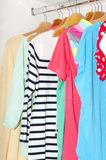 Colorful clothes for choice in the wardrobe Royalty Free Stock Photography