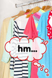 Colorful clothes for choice in the wardrobe  Royalty Free Stock Photos